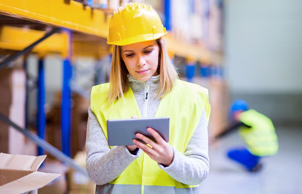 A female warehouse worker using an Android-powered tablet.