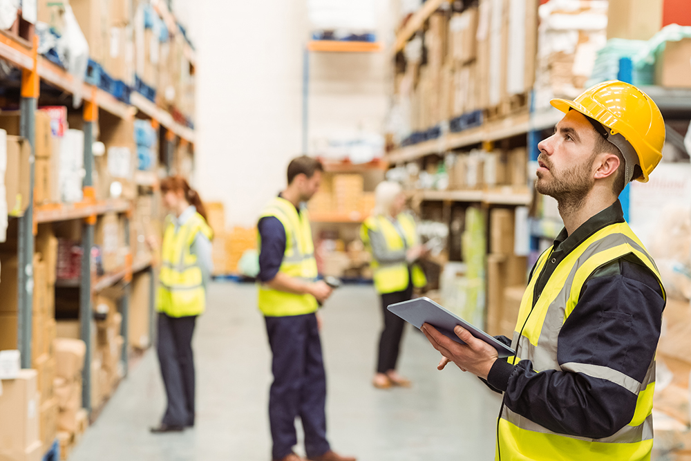 Warehouse workers using devices that are managed and secured by the SOTI ONE Platform