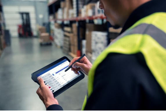 A warehouse worker using a Samsung tablet that is managed and secured by the SOTI ONE Platform